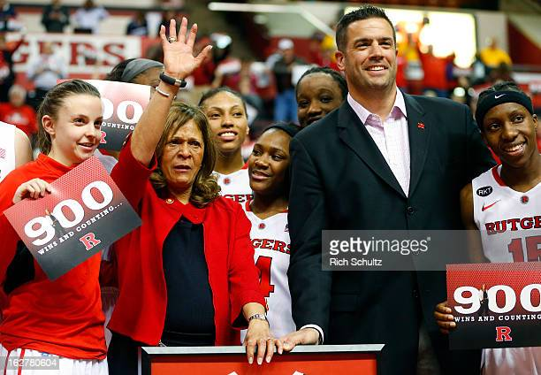 Head coach C Vivian Stringer of the Rutgers Scarlet Knights and Athletic Director Tim Pernetti are surrounded by players after defeating the South...