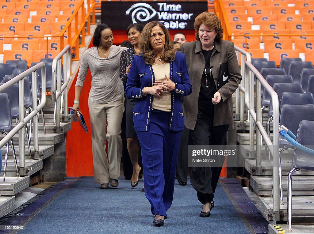 Head coach C. Vivian Stringer of the Rutgers Scarlet Knights enters the court next to assistant to the head coach Betsy Yonkman prior to the game against the Syracuse Orange at the Carrier Dome on February 19, 2013 in Syracuse, New York.