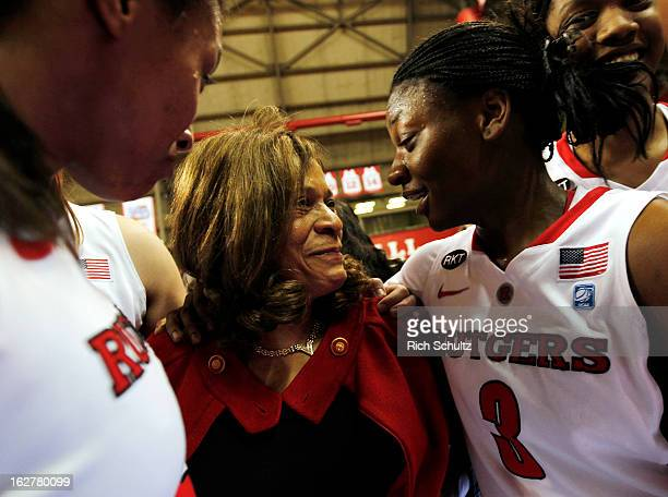Head coach C Vivian Stringer of the Rutgers Scarlet Knights is congratulated by Erica Wheeler after defeating the South Florida Bulls 6856 in a game...