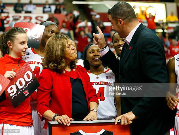 Head coach C Vivian Stringer of the Rutgers Scarlet Knights is congratulated by Athletic Director Tim Pernetti after defeating the South Florida...