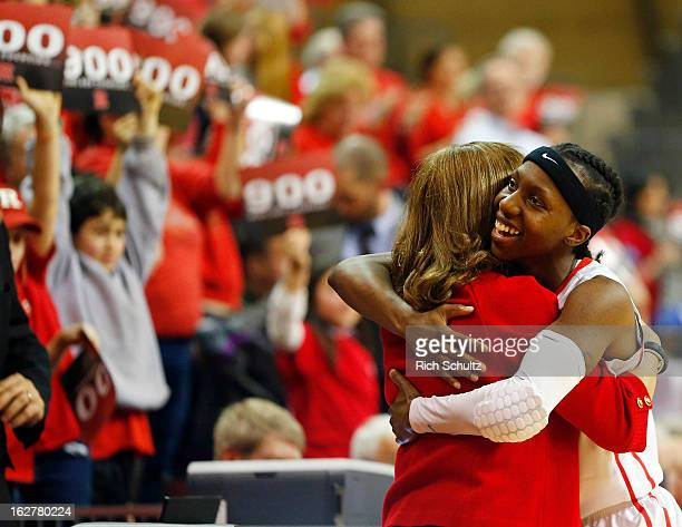 Head coach C Vivian Stringer of the Rutgers Scarlet Knights is hugged by her player Syessence Davis after defeating the South Florida Bulls 6856 in a...