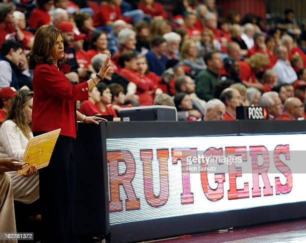Head coach C Vivian Stringer of the Rutgers Scarlet Knights signals to her team during a game against the South Florida Bulls in a game at the Louis...