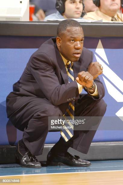 Head coach Carl Hobbs of the George Washington Colonials looks on during the BBT College Basketball Classic game against the Connecticut Huskies at...