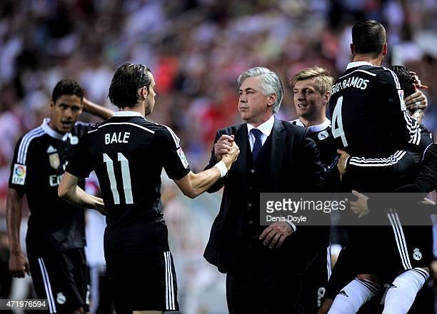Head coach Carlo Ancelott of Real Madrid celebrates with Gareth Bale after Cristiano Ronaldo scored his team's 3rd goal during the La Liga match...