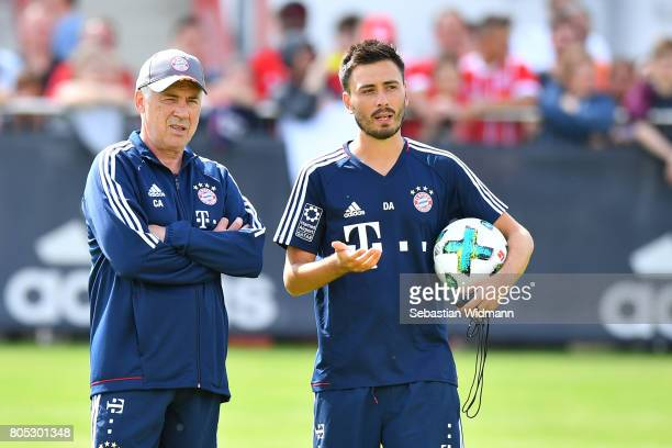 Head coach Carlo Ancelotti and assistant coach Davide Ancelotti of FC Bayern Muenchen talk during a training session at Saebener Strasse training...