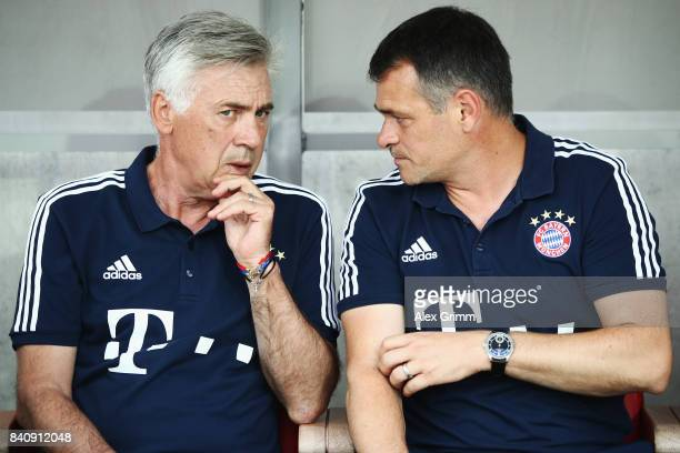 Head coach Carlo Ancelotti and assistant coach Willy Sagnol of Muenchen chat prior to a friendly match between Kickers Offenbach and FC Bayern...