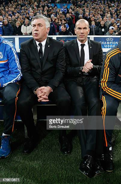Head coach Carlo Ancelotti and assistant coach Zinedine Zidane of Real Madrid attend the UEFA Champions League Round of 16 first leg match between...