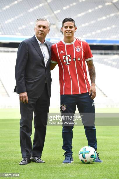 Head coach Carlo Ancelotti and James Rodriguez pose for a picture on the pitch of the Allianz Arena on July 12 2017 in Munich Germany