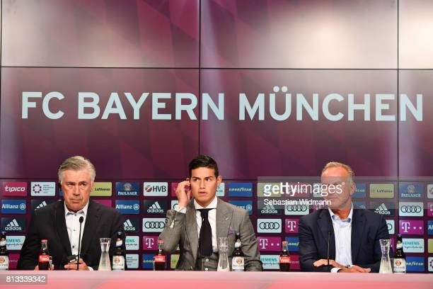 Head coach Carlo Ancelotti and KarlHeinz Rummenigge CEO of FC Bayern Muenchen present James Rodriguez at a press conference at Allianz Arena on July...