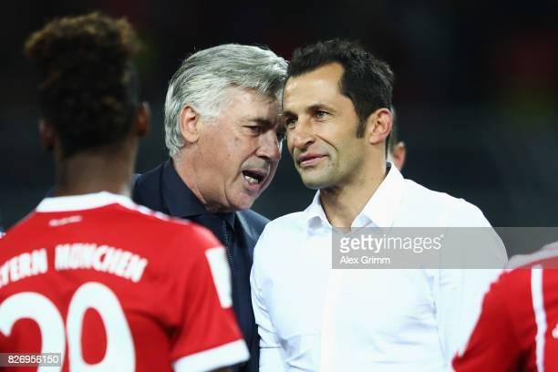 Head coach Carlo Ancelotti and sports director Hasan Salihamidzic chat after their team won the DFL Supercup 2017 match between Borussia Dortmund and...
