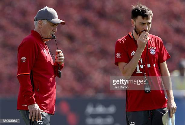 Head coach Carlo Ancelotti is seen with assistant coach Davide Ancelotti during a training session at day 2 of the Bayern Muenchen training camp at...