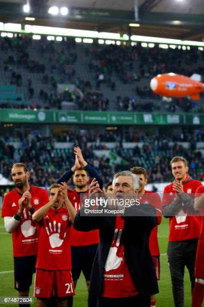 Head coach Carlo Ancelotti of Bayern celebrates after winning the German Championship after winning 60 the Bundesliga match between VfL Wolfsburg and...