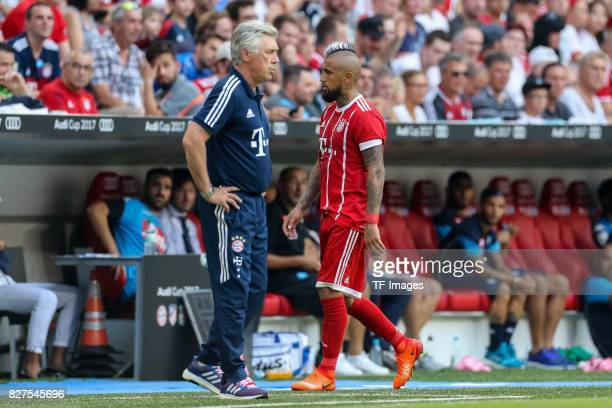 Head coach Carlo Ancelotti of Bayern Muenchen and Arturo Erasmo Vidal of Bayern Muenchen looks on during the Audi Cup 2017 match between SSC Napoli...