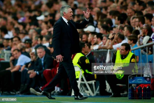 Head coach Carlo Ancelotti of Bayern Muenchen reacts as he walks to the bench during the UEFA Champions League Quarter Final second leg match between...