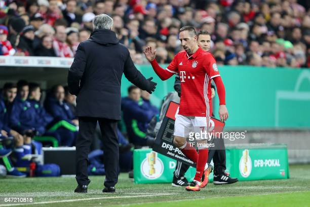 Head coach Carlo Ancelotti of Bayern Muenchen shakes hands with Franck Ribery of Bayern Muenchen during the DFB Cup quarter final between Bayern...
