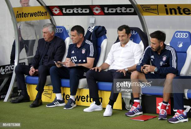 Head coach Carlo Ancelotti of Muenchen and Cocoach Willy Sagnol of Muenchen and Hasan Salihamidzic of Muenchen and Davide Ancelotti looks on during...