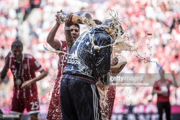 Head coach Carlo Ancelotti of Muenchen gets a beer shower after the Bundesliga match between Bayern Muenchen and SC Freiburg at Allianz Arena on May...