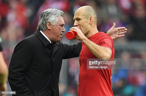 Head coach Carlo Ancelotti of Muenchen talks to Arjen Robben of Muenchen during the Bundesliga match between Bayern Muenchen and TSG 1899 Hoffenheim...