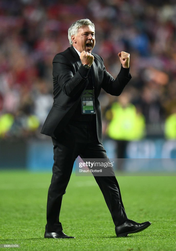 Head Coach, <a gi-track='captionPersonalityLinkClicked' href=/galleries/search?phrase=Carlo+Ancelotti&family=editorial&specificpeople=226747 ng-click='$event.stopPropagation()'>Carlo Ancelotti</a> of Real Madrid celebrates victory in the UEFA Champions League Final between Real Madrid and Atletico de Madrid at Estadio da Luz on May 24, 2014 in Lisbon, Portugal.
