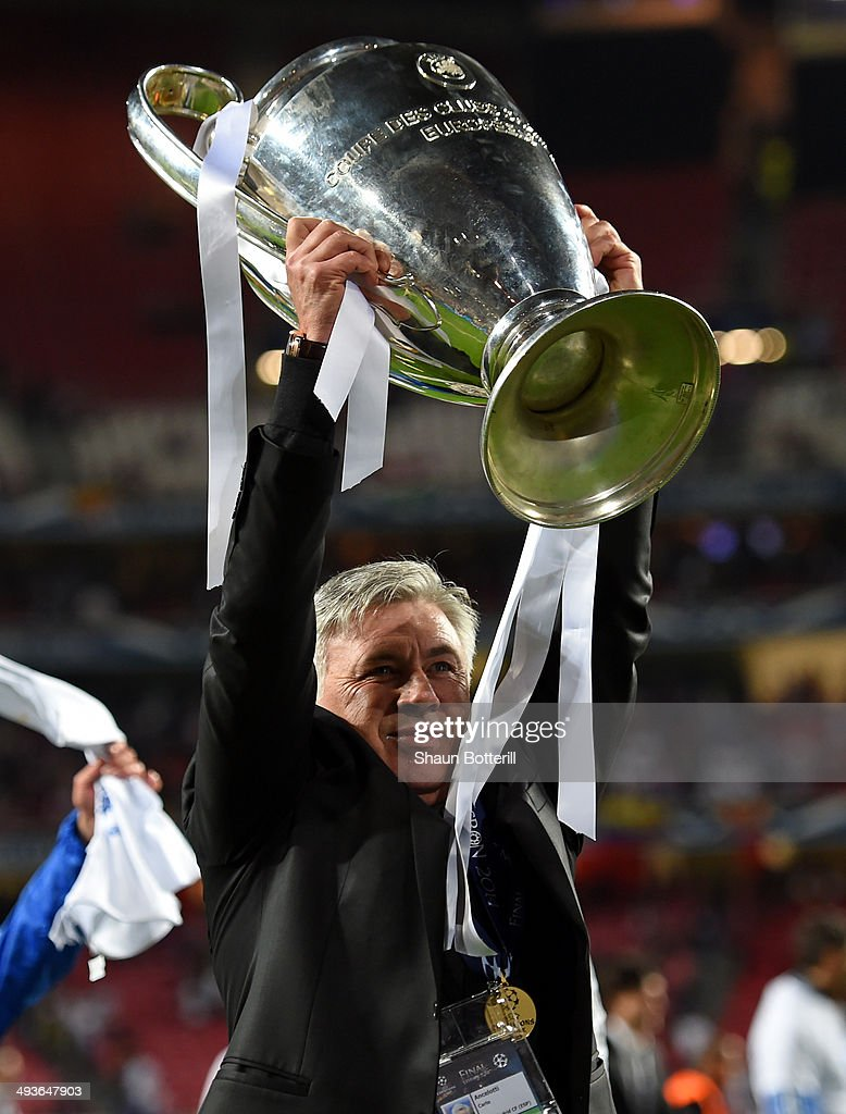 Head Coach, Carlo Ancelotti of Real Madrid celebrates with the Champions League trophy during the UEFA Champions League Final between Real Madrid and Atletico de Madrid at Estadio da Luz on May 24, 2014 in Lisbon, Portugal.