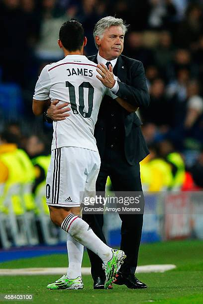 Head coach Carlo Ancelotti of Real Madrid CF embraces his player James Rodriguez after being replaced by Gareth Bale during the UEFA Champions League...
