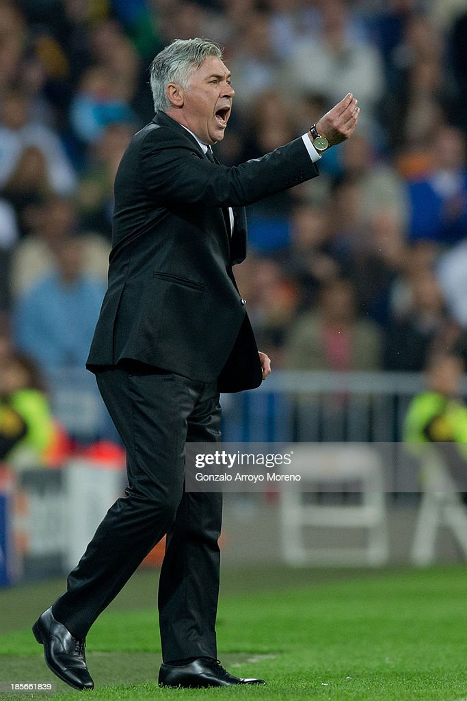 head coach <a gi-track='captionPersonalityLinkClicked' href=/galleries/search?phrase=Carlo+Ancelotti&family=editorial&specificpeople=226747 ng-click='$event.stopPropagation()'>Carlo Ancelotti</a> of Real Madrid CF gives instructions during the UEFA Champions League Group B match between Real Madrid CF and Juventus at Estadio Santiago Bernabeu on October 23, 2013 in Madrid, Spain.