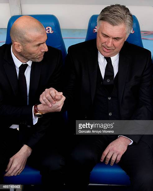 Head coach Carlo Ancelotti of Real Madrid CF shakes hands with his assistant coach Zinedine Zidane prior to the start of the La Liga match between...
