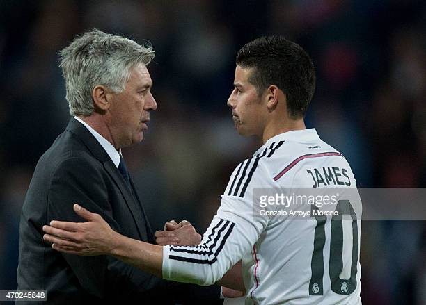 Head coach Carlo Ancelotti of Real Madrid CF shakes hands with his player James Rodriguez after the La Liga match between Real Madrid CF and Malaga...