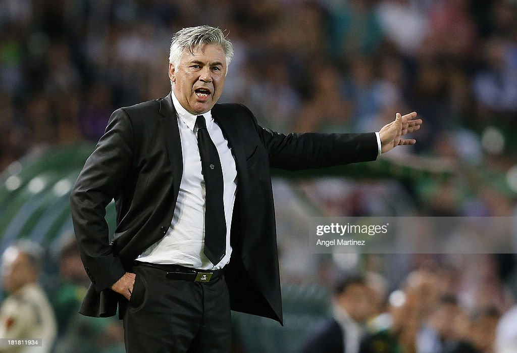 Head coach <a gi-track='captionPersonalityLinkClicked' href=/galleries/search?phrase=Carlo+Ancelotti&family=editorial&specificpeople=226747 ng-click='$event.stopPropagation()'>Carlo Ancelotti</a> of Real Madrid gestures during the La Liga match between Elche FC and Real Madrid at Estadio Manuel Martinez Valero on September 25, 2013 in Elche, Spain.