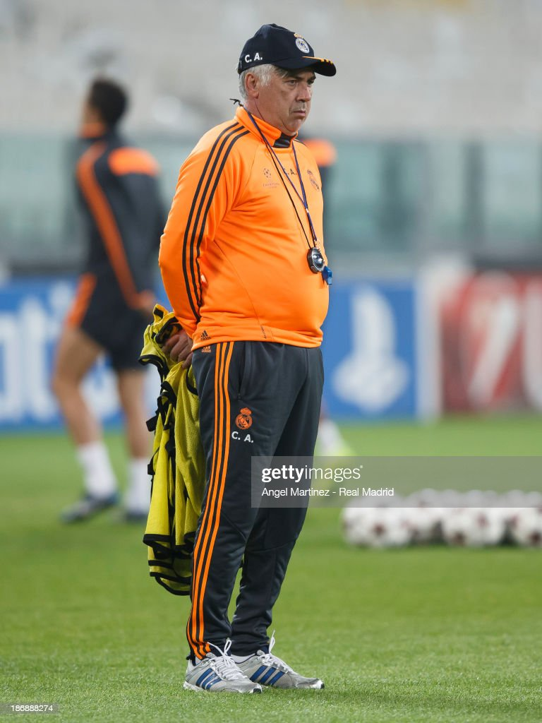 Head coach <a gi-track='captionPersonalityLinkClicked' href=/galleries/search?phrase=Carlo+Ancelotti&family=editorial&specificpeople=226747 ng-click='$event.stopPropagation()'>Carlo Ancelotti</a> of Real Madrid looks on during a training session ahead of their UEFA Champions League Group B match against Juventus at Juventus Arena on November 4, 2013 in Turin, Italy.