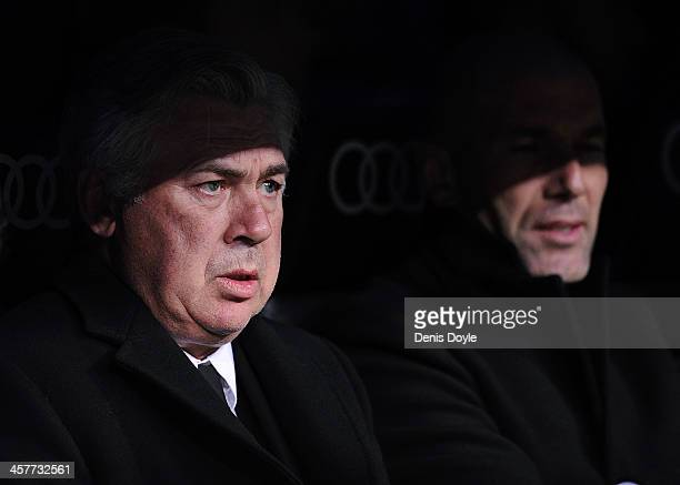 Head coach Carlo Ancelotti of Real Madrid looks on with assistant coach Zinedine Zidane during the start of the Copa del Rey Round of 32 2nd leg...