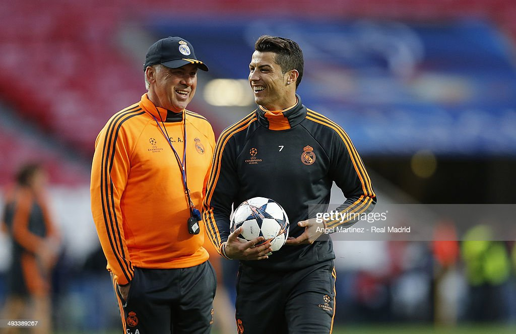 Head Coach <a gi-track='captionPersonalityLinkClicked' href=/galleries/search?phrase=Carlo+Ancelotti&family=editorial&specificpeople=226747 ng-click='$event.stopPropagation()'>Carlo Ancelotti</a> (L) of Real Madrid shares a joke with <a gi-track='captionPersonalityLinkClicked' href=/galleries/search?phrase=Cristiano+Ronaldo+-+Jogador+de+futebol&family=editorial&specificpeople=162689 ng-click='$event.stopPropagation()'>Cristiano Ronaldo</a> during a Real Madrid training session ahead of the UEFA Champions League Final against Club Atletico de Madrid at Estadio da Luz on May 23, 2014 in Lisbon, Portugal.