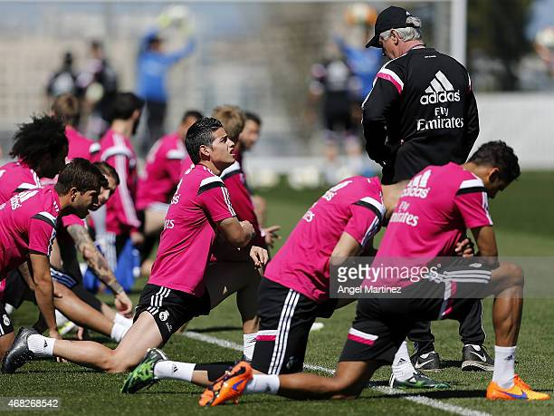 Head coach Carlo Ancelotti of Real Madrid talks to James Rodriguez during a training session at Valdebebas training ground on April 1 2015 in Madrid...