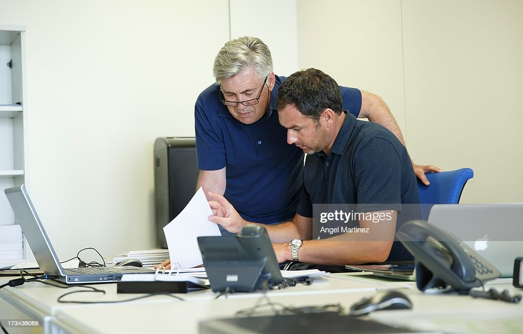 Head coach <a gi-track='captionPersonalityLinkClicked' href=/galleries/search?phrase=Carlo+Ancelotti&family=editorial&specificpeople=226747 ng-click='$event.stopPropagation()'>Carlo Ancelotti</a> (L) of Real Madrid talks with his assistant Paul Clement at Valdebebas training ground as they start their tenure with the club on July 14, 2013 in Madrid, Spain.