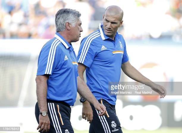 Head coach Carlo Ancelotti of Real Madrid talks with his assistant Zinedine Zidane during the International Champions Cup 2013 match between Everton...