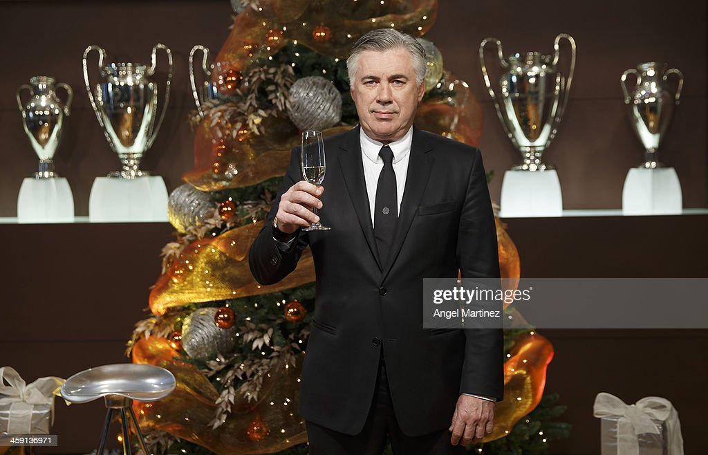Head coach <a gi-track='captionPersonalityLinkClicked' href=/galleries/search?phrase=Carlo+Ancelotti&family=editorial&specificpeople=226747 ng-click='$event.stopPropagation()'>Carlo Ancelotti</a> poses during a Real Madrid Christmas portrait session at Estadio Santiago Bernabeu on December 23, 2013 in Madrid, Spain.