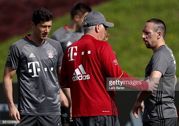 Head coach Carlo Ancelotti speaks with Robert Lewandowski and Franck Ribery during a training session at day 3 of the Bayern Muenchen training camp...