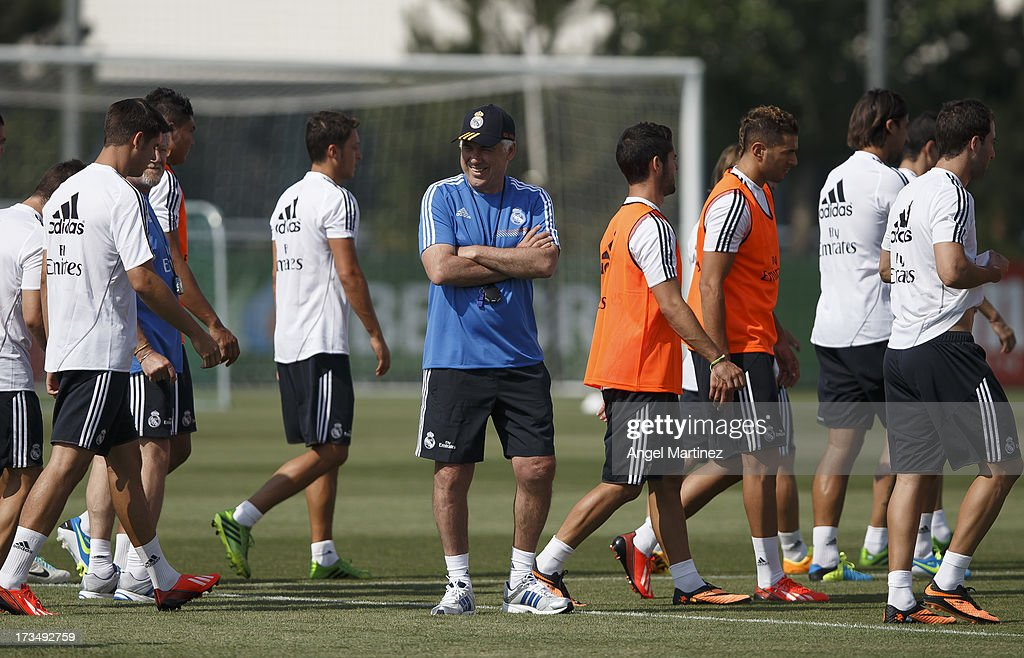 Head coach Carlos Ancelotti (C) of Real Madrid smiles during a training session at Valdebebas training ground on July 15, 2013 in Madrid, Spain.