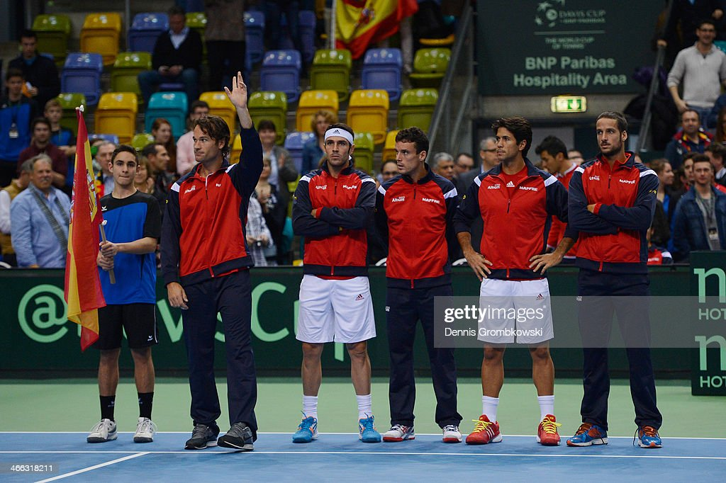 Head coach <a gi-track='captionPersonalityLinkClicked' href=/galleries/search?phrase=Carlos+Moya&family=editorial&specificpeople=171236 ng-click='$event.stopPropagation()'>Carlos Moya</a> of Spain reacts next to his team <a gi-track='captionPersonalityLinkClicked' href=/galleries/search?phrase=David+Marrero&family=editorial&specificpeople=5357971 ng-click='$event.stopPropagation()'>David Marrero</a>, Roberto Bautista Agut, Fernando Verdasco and Feliciano Lopez on Day 2 of the Davis Cup First round match between Germany and Spain at Fraport Arena on February 1, 2014 in Frankfurt am Main, Germany.