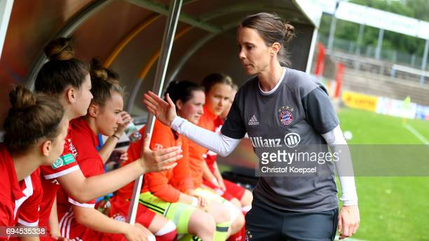 Head coach Carmen Roth of Bayern shake hands with the players from the substitute bench prior to the B Junior Girl's German Championship Semi Final...
