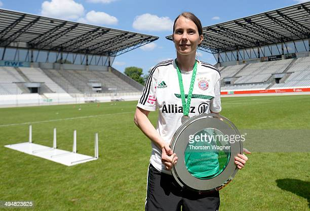 Head coach Carmen Roth of Muenchen pose after winning the girls bjunior final match between FC Bayern Muenchen and 1FFC Turbine Potsdam at stadium...