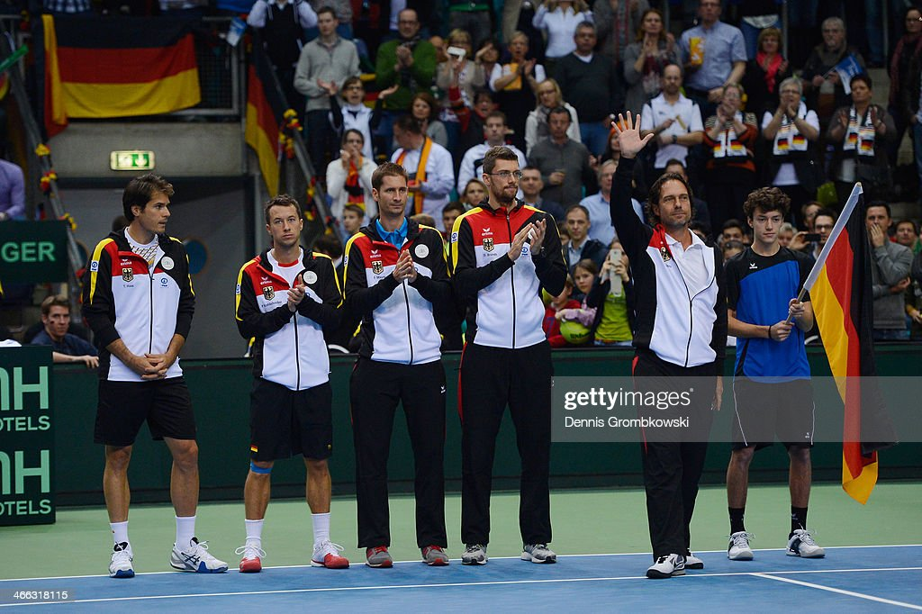 Head coach Carsten Arriens of Germany reacts next to his team Tommy Haas Philipp Kohlschreiber Florian Mayer and Daniel Brands on Day 2 of the Davis...
