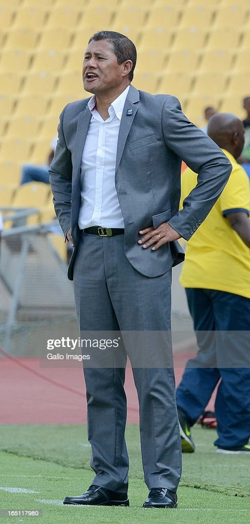 Head coach Cavin Johnson of the Stars stands on the touchline during the Absa Premiership match between Platinum Stars and Mamelodi Sundowns from Royal Bafokeng Stadium on March 30, 2013 in Rustenburg, South Africa.
