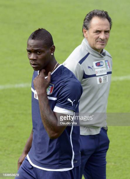 Head coach Cesare Prandelli and Mario Balotelli of Italy during a training session ahead of their FIFA World Cup qualifier against Armenia at...