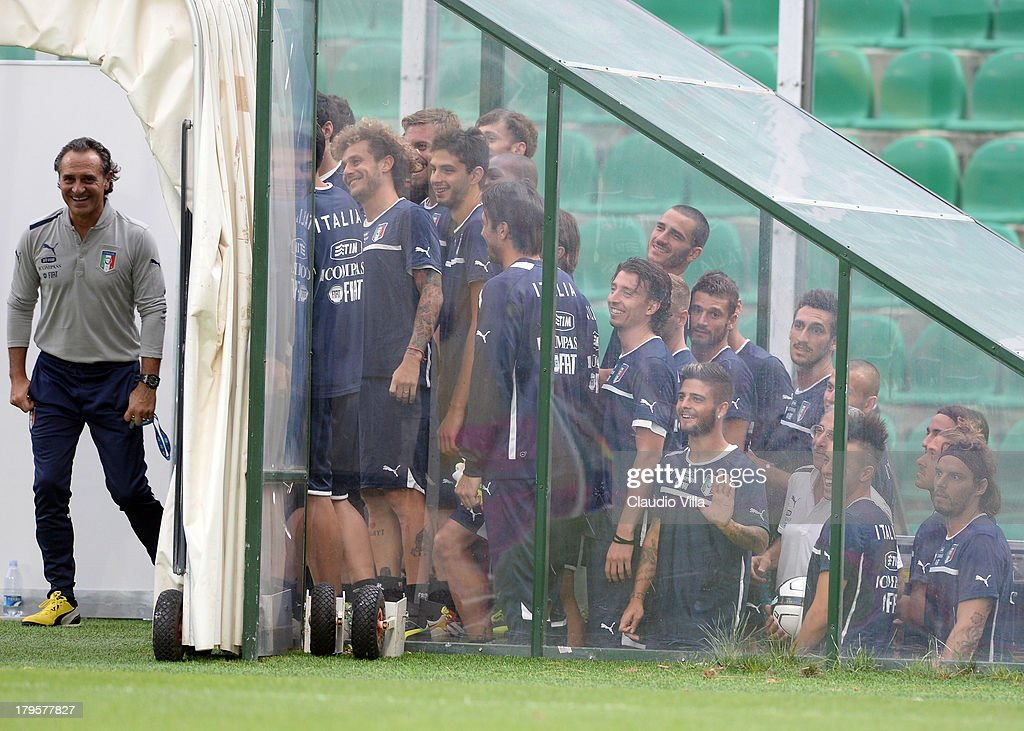 Head coach Cesare Prandelli (L) and players of Italy walk out onto the pitch during a training session at Stadio Renzo Barbera on September 5, 2013 in Palermo, Italy.