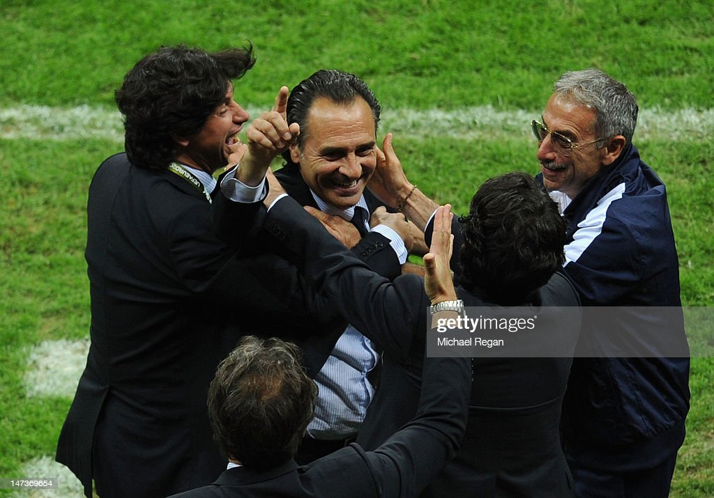 Head Coach Cesare Prandelli (C) of Italy celebrates with his coaching staff and vice-president of the Italian Football Federartion Demetrio Albertini (L) during the UEFA EURO 2012 semi final match between Germany and Italy at National Stadium on June 28, 2012 in Warsaw, Poland.