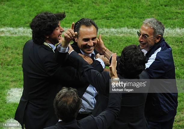 Head Coach Cesare Prandelli of Italy celebrates with his coaching staff and vicepresident of the Italian Football Federartion Demetrio Albertini...