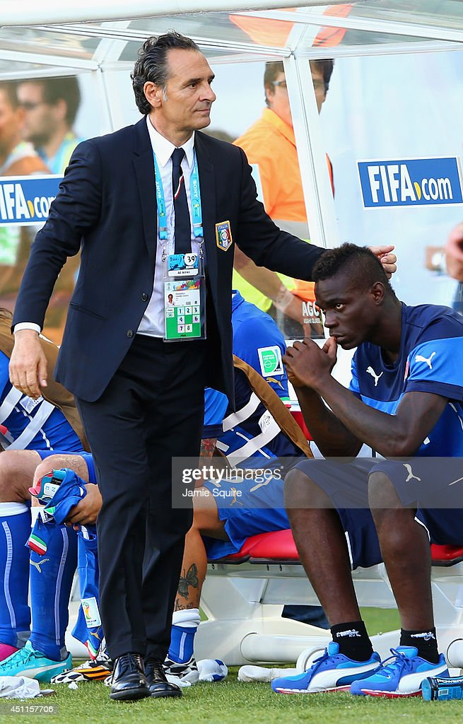 Head coach <a gi-track='captionPersonalityLinkClicked' href=/galleries/search?phrase=Cesare+Prandelli&family=editorial&specificpeople=742442 ng-click='$event.stopPropagation()'>Cesare Prandelli</a> of Italy consoles <a gi-track='captionPersonalityLinkClicked' href=/galleries/search?phrase=Mario+Balotelli&family=editorial&specificpeople=4940446 ng-click='$event.stopPropagation()'>Mario Balotelli</a> during the 2014 FIFA World Cup Brazil Group D match between Italy and Uruguay at Estadio das Dunas on June 24, 2014 in Natal, Brazil.