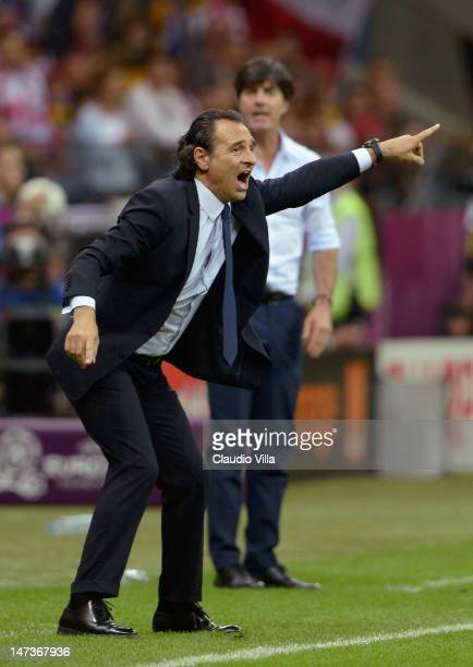 Head Coach Cesare Prandelli of Italy issues instructions to his players next to Head Coach Joachim Loew of Germany during the UEFA EURO 2012 semi...