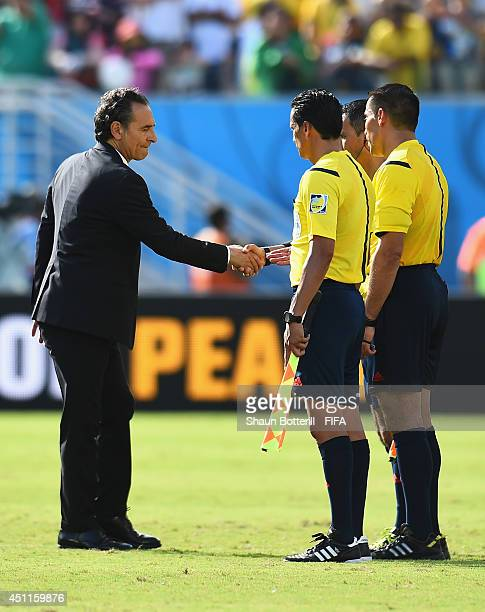 Head coach Cesare Prandelli of Italy shakes hands with referees after the 01 defeat in the 2014 FIFA World Cup Brazil Group D match between Italy and...